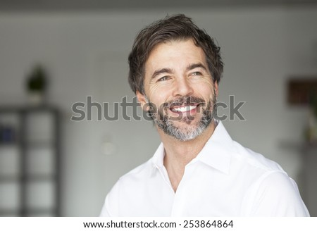 Successful Mature Man Smiling Looking Away - stock photo