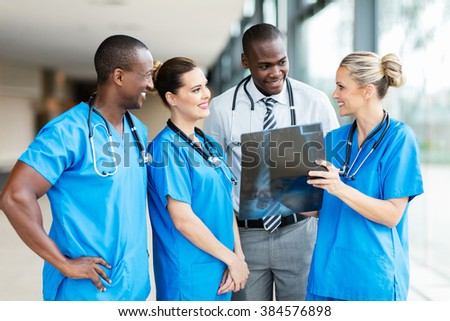 successful medical team working together in hospital - stock photo