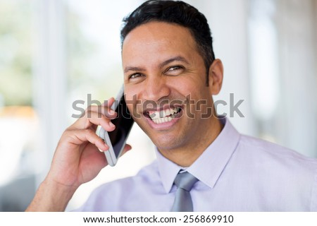 successful middle aged business man talking on cell phone - stock photo