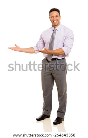 successful middle aged businessman doing welcome gesture on white background - stock photo