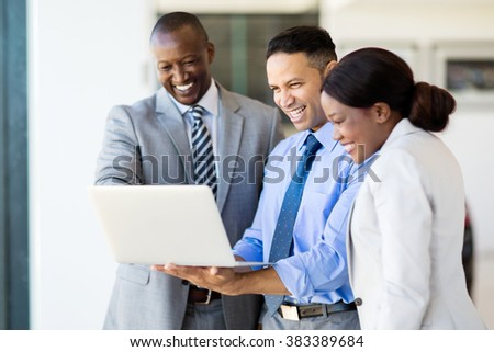 successful multiracial businesspeople using laptop computer - stock photo