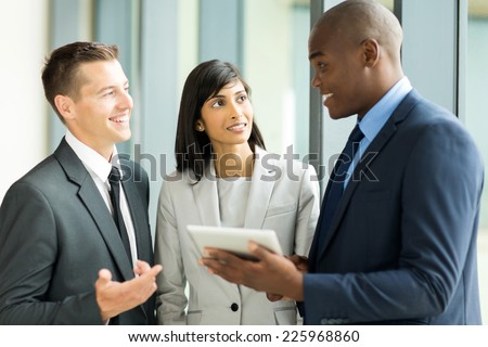 successful multiracial businesspeople working on tablet pc - stock photo