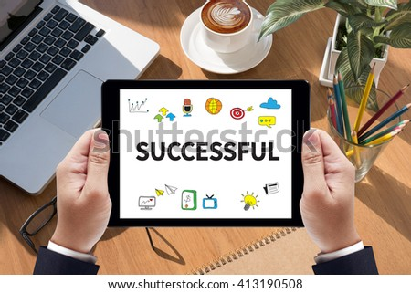 SUCCESSFUL on tablet on screen, table and coffee Business - stock photo