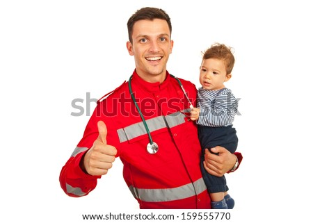 Successful paramedic give thumb up and holding baby boy isolated on white background