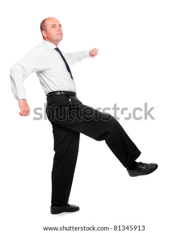 Successful senior businessman walking on a white. - stock photo