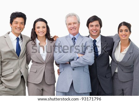 Successful senior businessman with his team against a white background