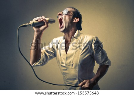 successful singer singing with the microphone - stock photo