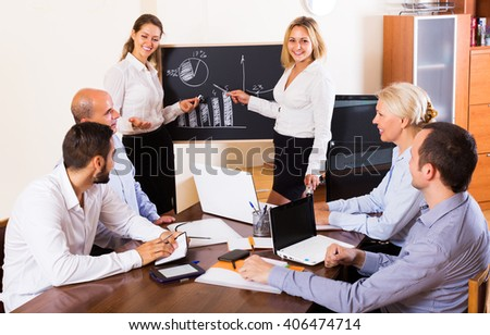 Successful smiling adult business people during conference call indoors - stock photo
