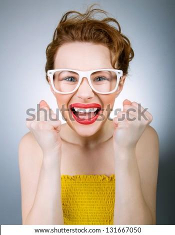 Successful smiling funny woman, studio shot - stock photo