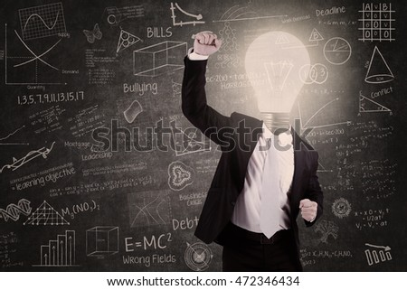 Successful teacher with lightbulb head in classroom