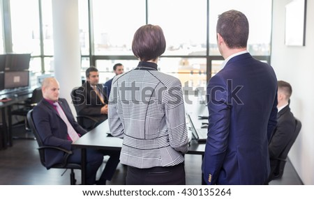 Successful team leader and business owner leading in-house business meeting, explaining business plans to his employees. Business and entrepreneurship concept. - stock photo