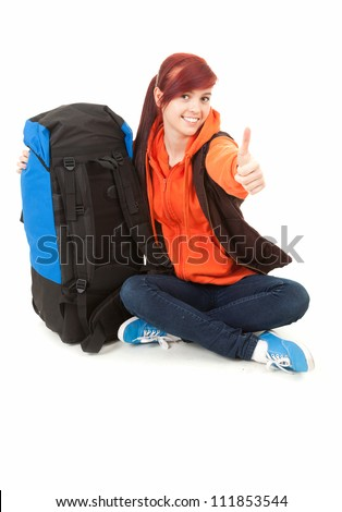 successful tourist girl with backpack and thumb up, full length, white background - stock photo