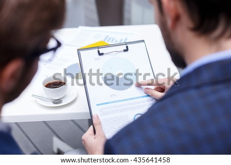 Successful two businessmen are working in cooperation - stock photo