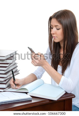 Successful woman at office workplace with mobile cell phone mobile texting on touch screen and smiling on a white background - stock photo