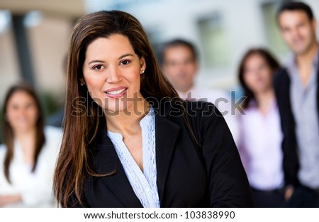 Successful woman at the office leading a business group