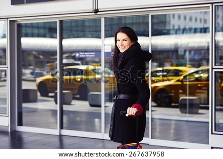 Successful woman in front of the terminal at the airport. - stock photo