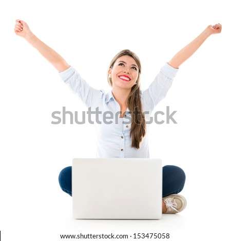 Successful woman online with arms up and a laptop - isolated over white  - stock photo