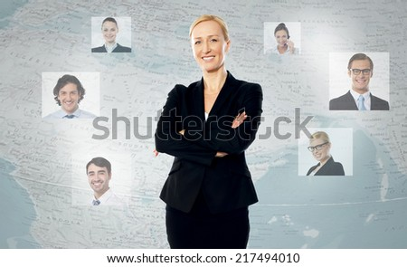 Successful woman standing, her friends across the world - stock photo