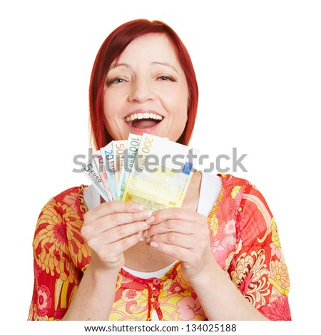 Successful woman with fan of Euro money bills - stock photo