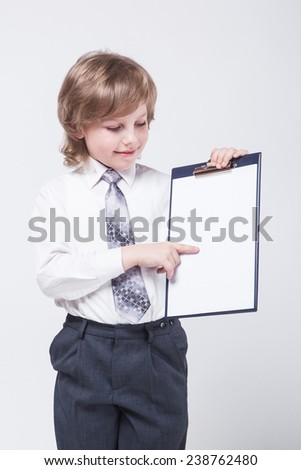 successful young ambitious businessman shows a graph of profit growth - stock photo