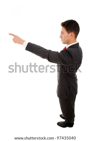 Successful young business man pointing at something interesting, isolated on white