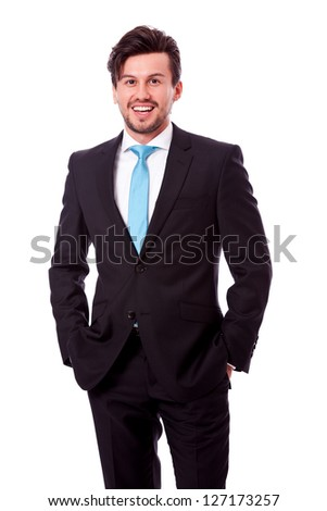 successful young business man smiling isolated on white background