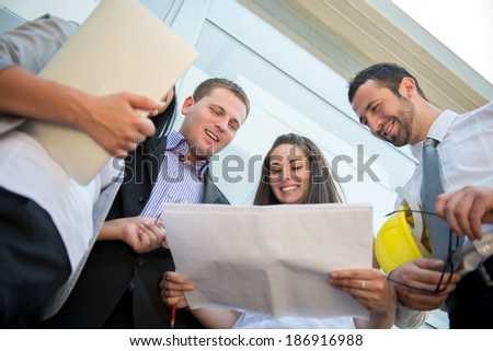 Successful young business people working in a team - stock photo