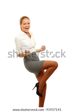 Successful young business woman happy for her success. Isolated full body image on white background.