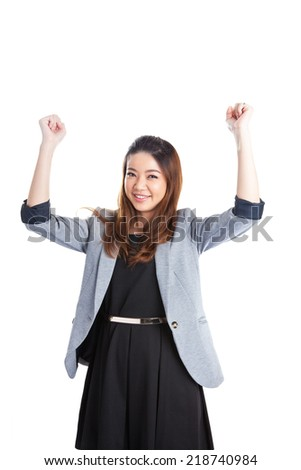 Successful young business xwoman happy for her success. Isolated full body image on white background. Mixed Asian / Caucasian businesswoman.