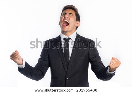Successful young businessman celebrating his victory isolated on white background  - stock photo