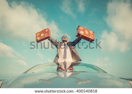 Successful young businessman on a beach. Man standing in the cabriolet classic car. Summer vacations and freedom travel concept. Toned image - stock photo
