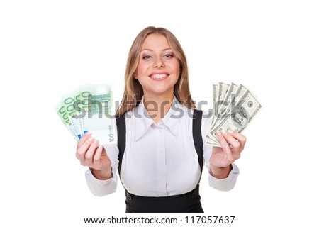 successful young businesswoman holding money and smiling. isolated on white background