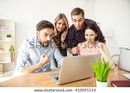 Successful young colleagues are expressing positive emotions - stock photo