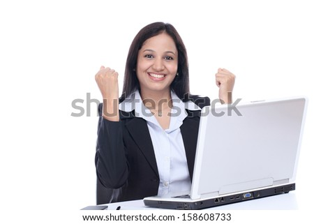 Successful young Indian business woman against white background