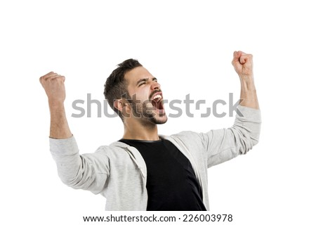 Successful young latin man with arms up - stock photo