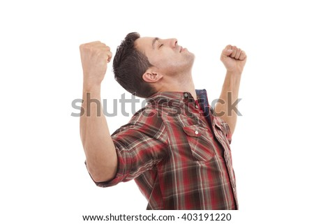 Successful young man with arms open, isolated over white background - stock photo