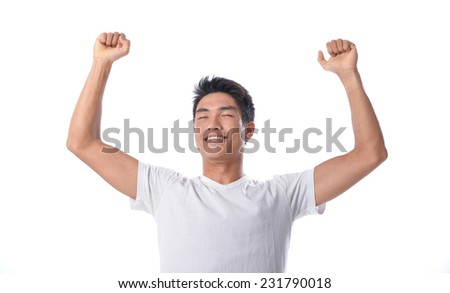 Successful young man with arms up - stock photo