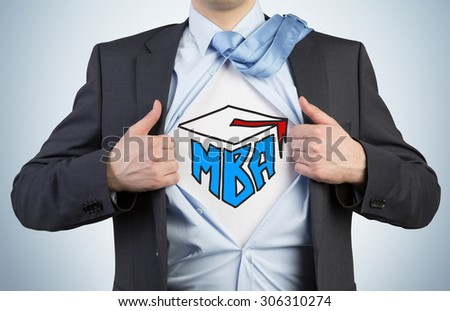 Successful young student is tearing the shirt. Business education icons are drawn on the chest. A concept of the MBA degree. - stock photo