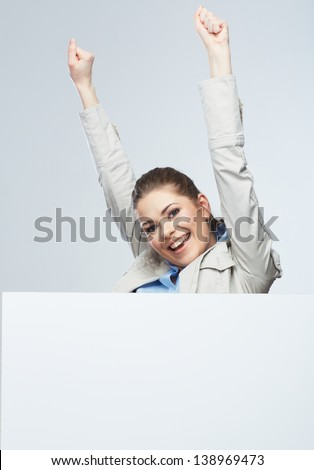 Successfull young business woman portrait out the blank white banner.Female happy model.