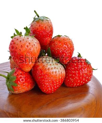 succulent juicy fresh ripe red strawberries on top wooden bowl isolated on white background