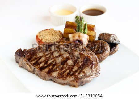 Succulent thick juicy portions of grilled fillet steak-Beef steak - stock photo