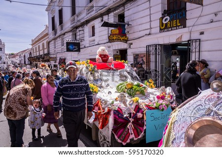 sucre bolivia on september 8 2015 street parade with decorated cars to celebrate