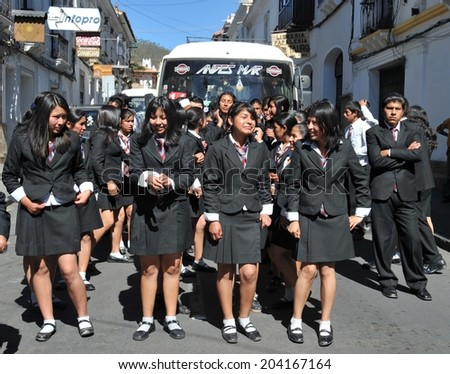 SUCRE; BOLIVIA - SEPTEMBER 6, 2010: Sucre is the official capital of Bolivia, seat of the Supreme Court. The city of churches and unique monasteries. Unidentified girls on the street of Sucre.