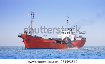 Suction dredger in work  - stock photo