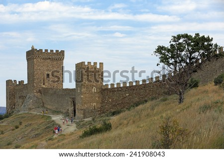 SUDAK, REPUBLIC OF CRIMEA, RUSSIA - AUG 07, 2014: The ruins of the medieval Genoese fortress in Sugdeya city (currently - Sudak). Tourists visiting the sights