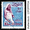SUDAN - CIRCA 1962: a stamp printed in Sudan shows Cotton Picker, Cotton Cultivation, circa 1962 - stock photo