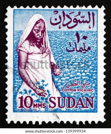 SUDAN - CIRCA 1962: a stamp printed in Sudan shows Cotton Picker, Cotton Cultivation, circa 1962 - stock photo