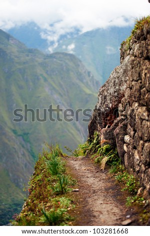 Sudden break of a narrow path at Machu Picchu, Peru - stock photo