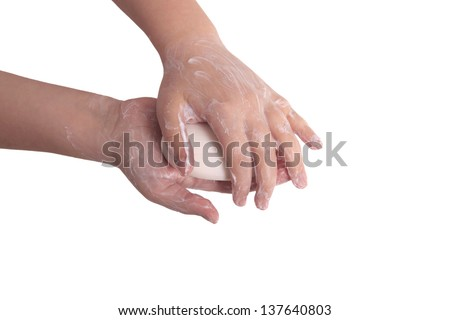 Sudsy hands with soap isolated on white