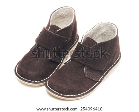 Suede baby shoes isolated on white background - stock photo